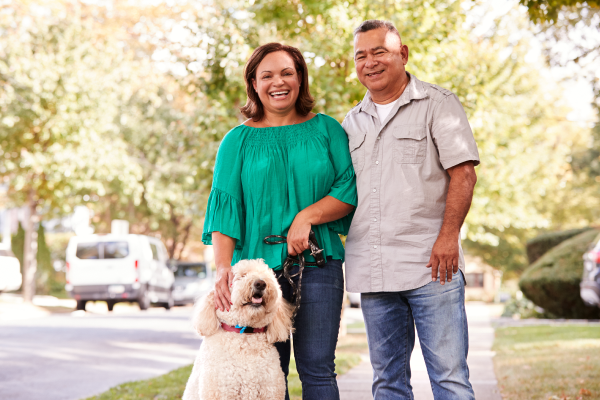 Man and Woman Smiling with Dog