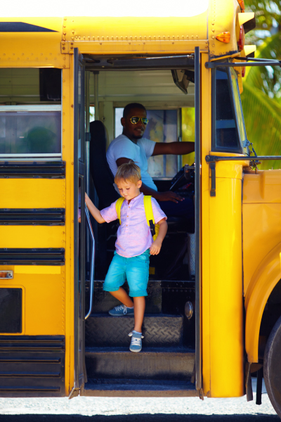 Young Boy Exiting School Bus